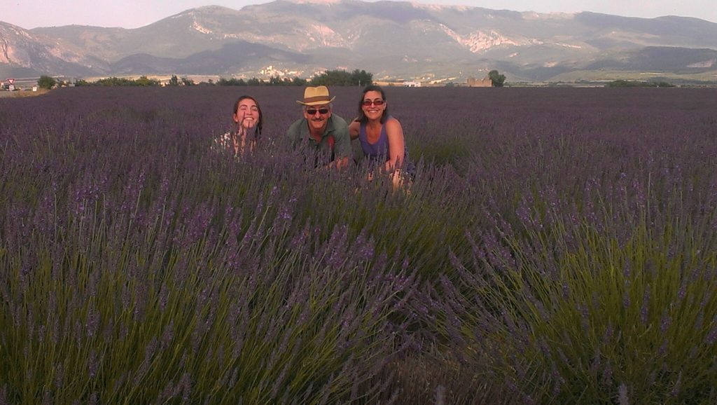 Alisa, Brian & Rosi amongst the buzzing bees in a lilac field near Folcalquier, Southern France Our way of Reclaiiming Rest and Play